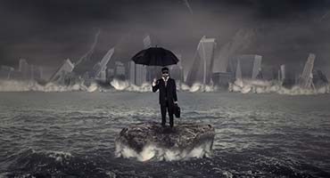 Concept of crisis storm in business with a businessman standing on the rock in the middle of a slight sea